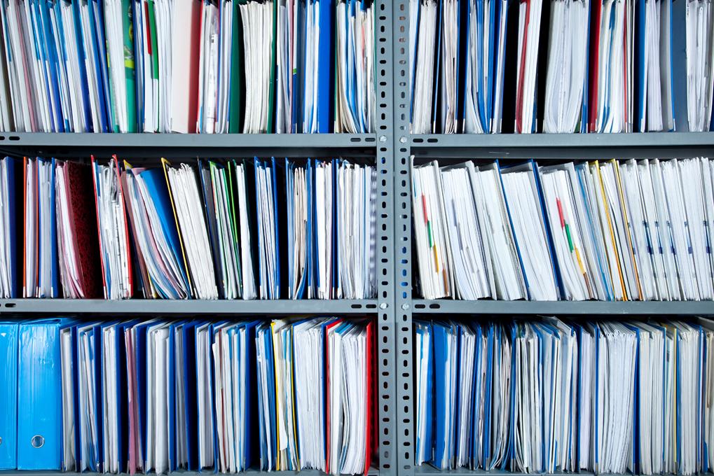binders on a shelf